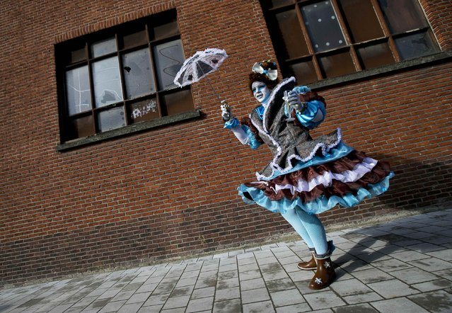 A reveller dances during the 87th carnival parade of Aalst February 15, 2015. (Photo by Yves Herman/Reuters)