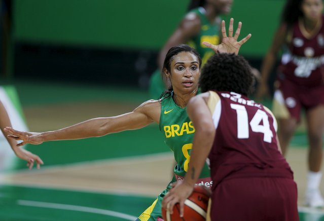 Iziane Castro (L) of Brazil defends against Waleska Perez of Venezuela during their women's basketball match, a test event for the Rio 2016 Olympic Games, at the Arena Carioca 1 in the Rio 2016 Olympic Park in Rio de Janeiro, Brazil, January 15, 2016. (Photo by Sergio Moraes/Reuters)