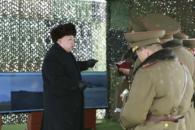 North Korean leader Kim Jong Un (L) guides artillery fire and landing exercises in this undated photo released by North Korea's Korean Central News Agency (KCNA) in Pyongyang February 21, 2015. (Photo by Reuters/KCNA)