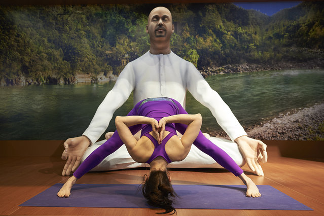 A woman practices yoga at the India stand during the International Tourism Trade Fair FITUR at Ifema on January 20, 2016 in Madrid, Spain. (Photo by Carlos Alvarez/Getty Images)