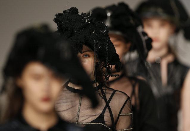 Models present creations by Hong Kong designer Sherman Kwan during the Hong Kong Fashion Week for Fall/Winter in Hong Kong, China January 18, 2016. (Photo by Bobby Yip/Reuters)