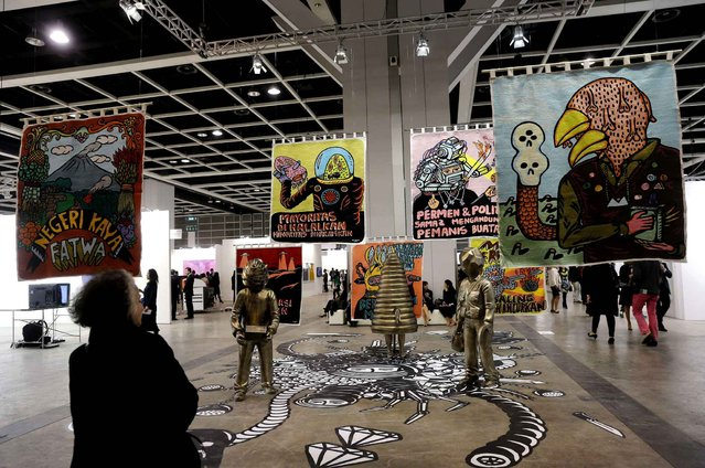 "An artwork ""Lot Lost"" created by Indonesian artist Eko Nugroho is displayed during the VIP preview of the art fair Art Basel in Hong Kong Friday, March 13, 2015. Art Basel stages modern and contemporary art shows and is held annually in Basel, Switzerland, Miami Beach, and Hong Kong. (Photo by Kin Cheung/AP Photo)"