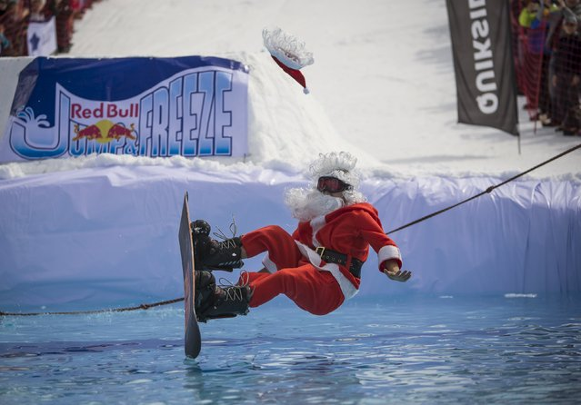 A snowboarder dressed as Santa Claus performs during the Red Bull Jump and Freeze competition at ski resort Shimbulak outside Almaty March 22, 2015. (Photo by Shamil Zhumatov/Reuters)