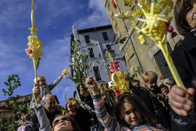 Children take part in a procession during Palm Sunday a few days prior to Holy Week, in Pamplona northern Spain, Sunday, March 29, 2015. (Photo by Alvaro Barrientos/AP Photo)