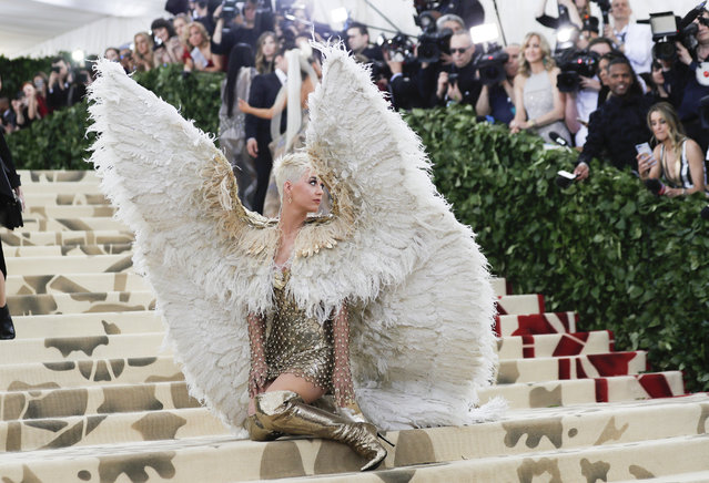 "Katy Perry arrives at the Metropolitan Museum of Art Costume Institute Gala (Met Gala) to celebrate the opening of ""Heavenly Bodies: Fashion and the Catholic Imagination"" in Manhattan, May 7, 2018. (Photo by Carlo Allegri/Reuters)"