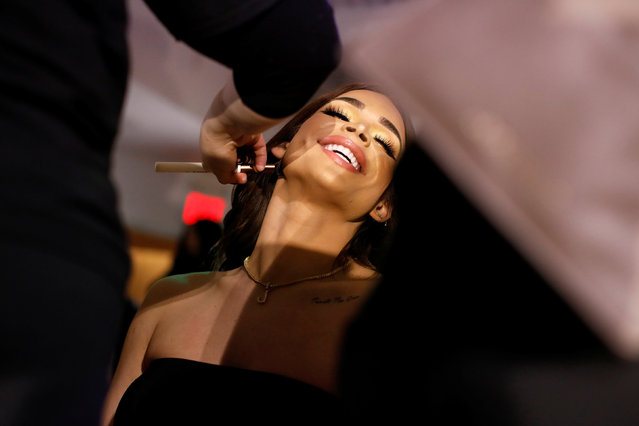 Transgender model and musician Jessica Cortez reacts as she is prepared before walking in the CHULO underwear show during New York Fashion Week, which raised money for transgender and cisgender young women victims of violence, in New York, U.S., February 7, 2019. (Photo by Andrew Kelly/Reuters)