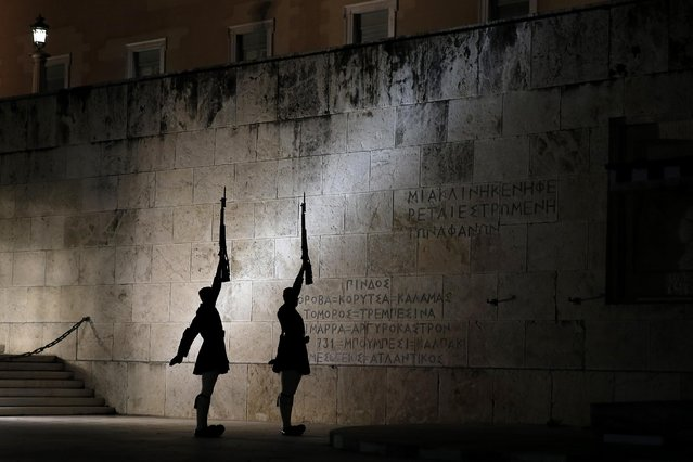 Presidential guards perform during a changing of the guard ceremony, at the tomb of the unknown soldier, in front of the Greek parliament in central Athens, Monday, April 6, 2015. (Photo by Petros Giannakouris/AP Photo)