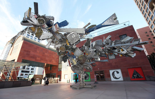 """Airplane Parts"", a sculpture by Nancy Rubins made of scraps of old airplanes wired together into a massive junk tree, greets visitors to the Museum of Contemporary Art Monday, January 6, 2014 in downtown Los Angeles. The museum, which struggled for years for financial survival, has quadrupled its endowment to more than $100 million in the past nine months through a fundraising campaign that museum officials say won support from dozens of deep-pocketed Los Angeles arts patrons. (Photo by Nick Ut/AP Photo)"