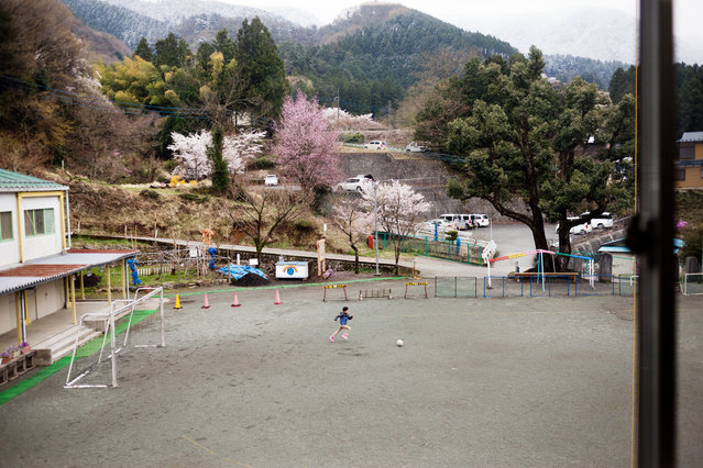 A student at the elementary school plays soccer alone on April 9, 2015. Nearly half the public elementary and junior high schools in Japan are smaller than government guidelines call for. (Photo by Ko Sasaki/The Washington Post)