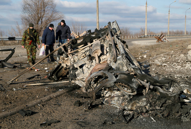 A view shows the wreckage of a minibus, which was destroyed by a landmine after swerving off road near the village of Yelenovka outside Donetsk, Ukraine on February 23, 2019. (Photo by Alexander Ermochenko/Reuters)