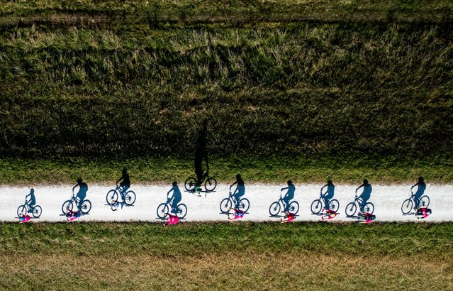 Wrong way buddy. Sport Highly Commended. One cyclist goes against the tide during the Big Easy cycling event in Hawkes Bay, New Zealand. The event attracts hundreds of cyclists on the region's cycle paths over the Easter weekend. (Photo by John Cowpland/Drone Photography Awards 2021)