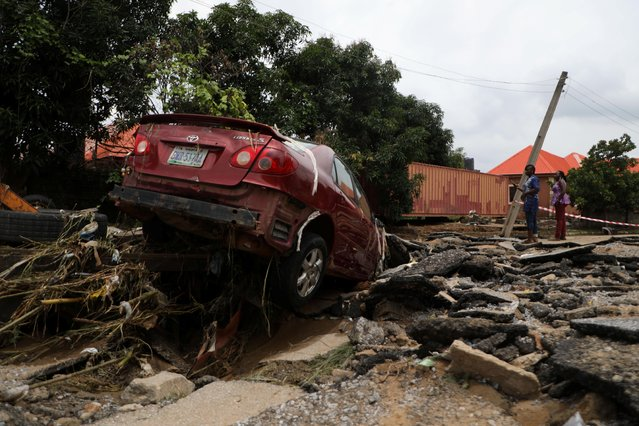 A car washed away during the flooding which destroyed several homes at Trademore estate Abuja, Nigeria on September 13, 2021. (Photo by Afolabi Sotunde/Reuters)