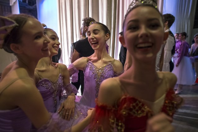 In this photo taken on Thursday, March  3, 2016, Harper Ortlieb, center, from Mount Hood, Oregon, and her ballet school colleagues congratulate each other after performing at the Bolshoi Ballet Academy in Moscow, Russia. (Photo by Alexander Zemlianichenko/AP Photo)