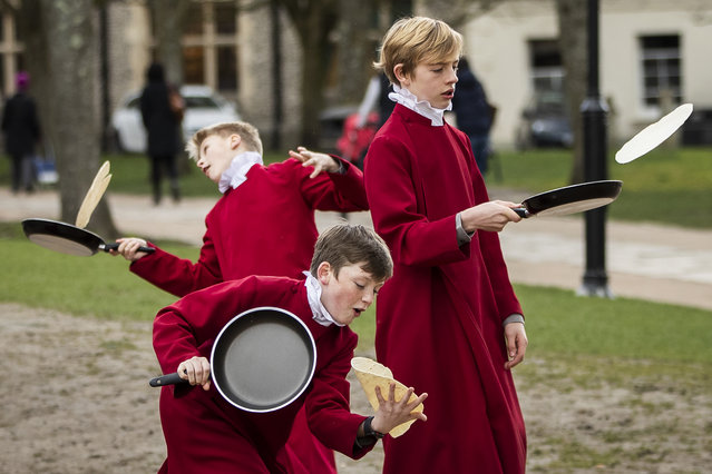 Choristers from Winchester Cathedral joke around in between being posed up for pictures by photographers on March 5, 2019 in Winchester, England. Winchester Cathedral held it's inaugural Shrove Tuesday Pancake day race in the Cathedral grounds today with money raised going to local charities. (Photo by Dan Kitwood/Getty Images)