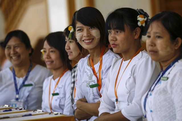 Parliament staff smile during a meeting at the lower house of Myammer's parliament in Naypyitaw March 10, 2016. (Photo by Soe Zeya Tun/Reuters)