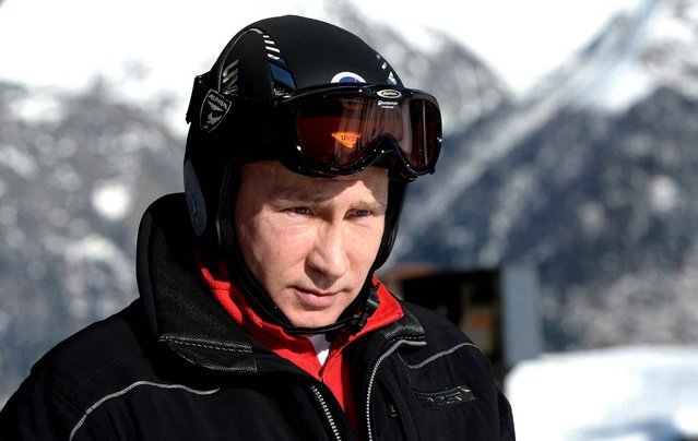 A picture taken on January 3, 2014, shows Russia's President Vladimir Putin visiting the mountain Laura Cross Country and Biathlon Centre near the Black Sea resort of Sochi. Sochi will host the 2014 Winter Olympics that start on February 7, 2014. (Photo by Alexei Nikolsky/AFP Photo/RIA-Novosti)