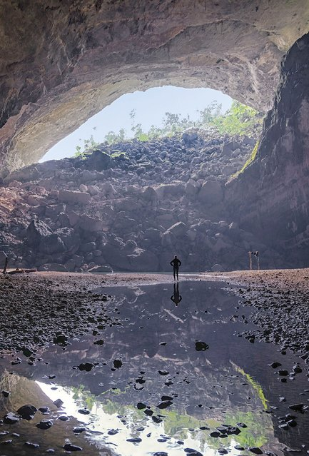 Looking out of the cave by the beach. (Photo by Lars Krux/Caters News)