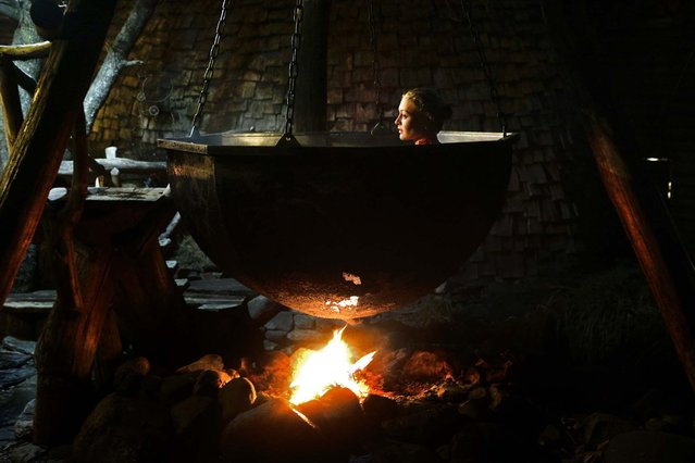 Olga Gharkova bathes in a hot pot. (Photo by Jae C. Hong/Associated Press)