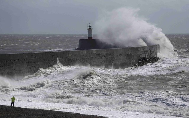 A man photographs waves crashing against the harbour wall at Newhaven in southern Britain March 28, 2016. (Photo by Neil Hall/Reuters)