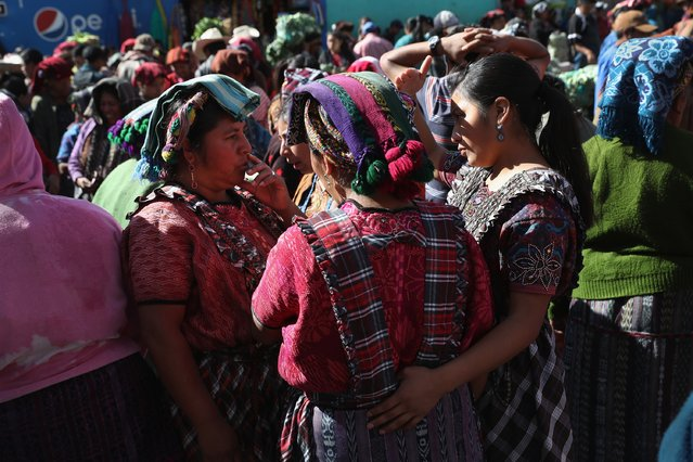 Vendors chat at a vegetable market on February 11, 2017 in Almolonga, Guatemala. (Photo by John Moore/Getty Images)