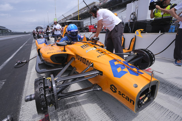 Fernando Alonso, of Spain, climbs into his car during practice for the Indianapolis 500 IndyCar auto race at Indianapolis Motor Speedway, Friday, May 17, 2019 in Indianapolis. (Photo by A.J. Mast/AP Photo)