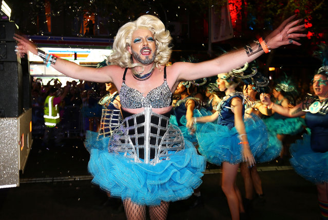 Parade goers dance during the 2017 Sydney Gay & Lesbian Mardi Gras Parade on March 4, 2017 in Sydney, Australia. (Photo by Brendon Thorne/Getty Images)