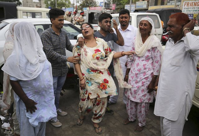 Relatives wail after the body of Kirpal Singh, an Indian prisoner who died in a Pakistan jail, was handed over to Indian authorities at Wagah border, on the outskirts of the northern city of Amritsar, India, April 19, 2016. (Photo by Munish Sharma/Reuters)