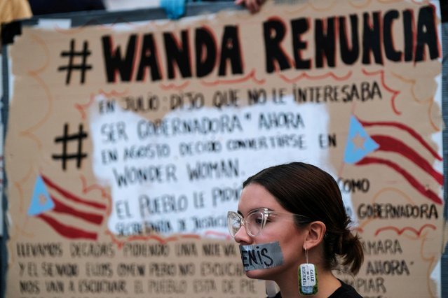 Demonstrators protest in front of La Fortaleza calling for the resignation of Wanda Vazquez, former Secretary of Justice and now Governor of Puerto Rico in San Juan, Puerto Rico on August 9, 2019. (Photo by Gabriella N. Baez/Reuters)