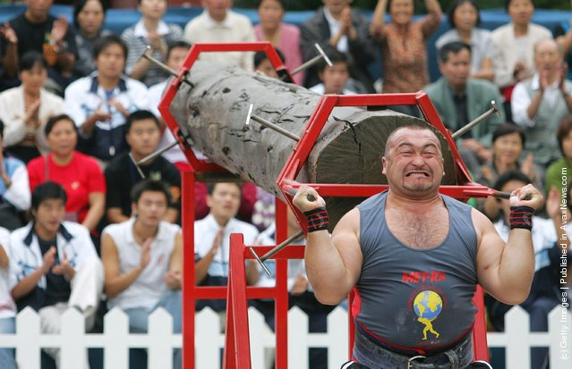 Elbrus Nigmatulin of Russia lifts a log during a match of the 2005 World's Strongest Man Competition at Wuhou Temple