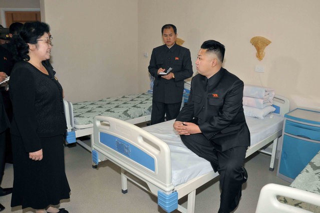 This picture released from North Korea's official Korean Central News Agency on November 5, 2012  shows North Korean leader Kim Jong Un (C) inspecting the newly built Breast Cancer Research Centre at the Pyongyang Maternity Hospital. (Photo by AFP Photo/KCNA via KNS)