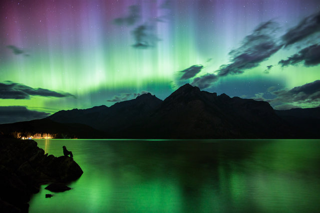 Lake Minnewanka, Banff National Park, Alberta, Canada. (Photo by Paul Zizka/Caters News Agency)