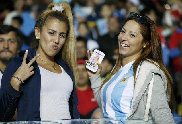 Argentina fans await the start of the team's Copa America 2015 semi-final soccer match against Paraguay at Estadio Municipal Alcaldesa Ester Roa Rebolledo in Concepcion, Chile, June 30, 2015. (Photo by Carlos Garcia Rawlins/Reuters)