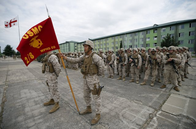 U.S. servicemen attend an opening ceremony for the military exercise Agile Spirit 2015 in Vaziani, Georgia, July 8, 2015. The exercise involves military personnel from Bulgaria, Georgia, Latvia, Lithuania, Romania and the United States. (Photo by David Mdzinarishvili/Reuters)