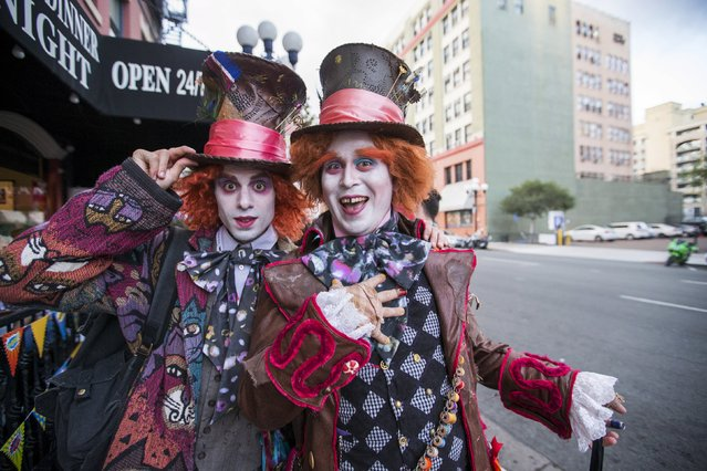 "Cosplay enthusiasts Jonathan Michael (L) and Connor Breen are dressed like the Mad Hatter from ""Alice in Wonderland"" during the 2015 Comic-Con International Convention in San Diego, California July 9, 2015. (Photo by Mario Anzuoni/Reuters)"