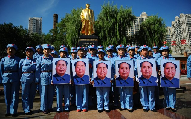 People pay respect to mark the 43th anniversary of former leader Mao Zedong's death on September 9, 2019 in Harbin, China. (Photo by Tao Zhang/Getty Images)