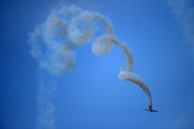 Pilot Eric Goujon flies on May 1, 2014 during a Red Bull flying and car show around the Danube River of Budapest downtown. (Photo by Attila Kisbenedek/AFP Photo)