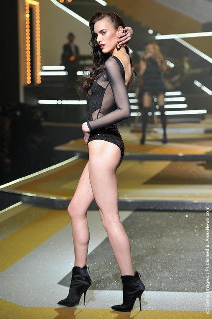 A model walks the runway during the Etam Spring / Summer 2012 Collection Launch at Les Beaux-Arts de Paris