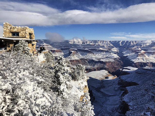 This Tuesday, January 1, 2019, photo shows Lookout Studio in Grand Canyon Village on the South Rim of Grand Canyon National Park in Arizona. While parts of the national park were closed due to the partial government shutdown, much of the park's South Rim was open and accessible. (Photo by Anna Johnson/AP Photo)