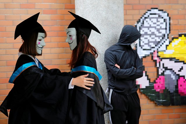 University students wearing Guy Fawkes masks pose for a photoshoot of a graduation ceremony to support anti-government protests at the Hong Kong Polytechnic University, in Hong Kong, China on October 30, 2019. (Photo by Tyrone Siu/Reuters)