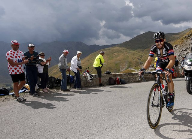 Giant-Alpecin rider Simon Geschke of Germany climbs the Allos pass to win the 161-km (100 miles) 17th stage of the 102nd Tour de France cycling race from Digne-les-Bains to Pra Loup in the French Alps mountains, France, July 22, 2015. (Photo by Eric Gaillard/Reuters)