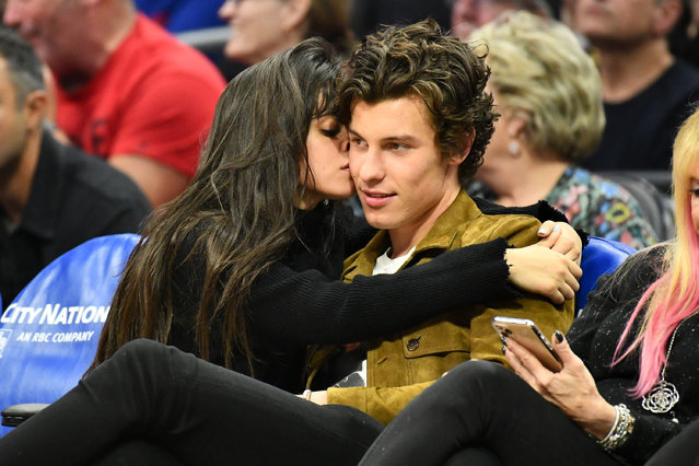 Camila Cabello and Shawn Mendes attend a basketball game between the Los Angeles Clippers and the Toronto Raptors at Staples Center on November 11, 2019 in Los Angeles, California. (Photo by Allen Berezovsky/Getty Images)