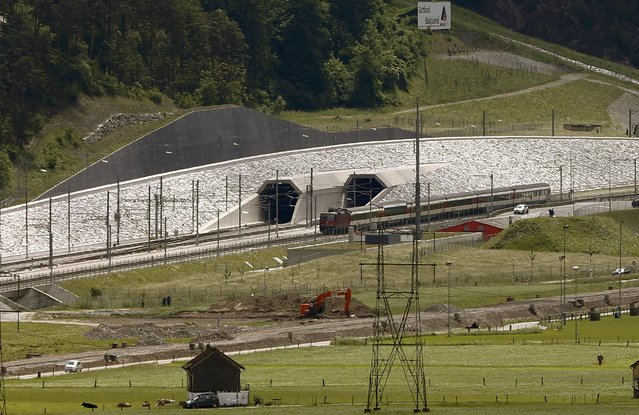 A train drives past the northern gates of the NEAT Gotthard Base Tunnel near the town of Erstfeld, Switzerland March 31, 2016. The 57.1-km (35.5 mile)-long Gotthard Base Tunnel, 17 years under construction and designed to last a century, is part of a 23 billion Swiss franc infrastructure project to speed passengers and cargo by rail under the mountain chain that divides Europe's north and south. (Photo by Arnd Wiegmann/Reuters)