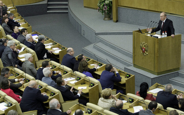Russian Prime Minister Vladimir Putin, right, addresses the State Duma (parliament's lower chamber) with his annual speech  in Moscow, Tuesday, April 20, 2010. (Photo by Misha Japaridze/AP Photo)