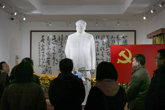 People visit a museum of artworks of the late former Chinese Communist Party leader Mao Zedong to mark his 126th birthday, in Nantong in China's eastern Jiangsu province on December 26, 2019. (Photo by AFP Photo/China Stringer Network)