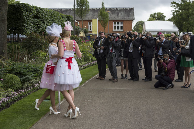Photographers take pictures of racegoers as they arrive during Day Three of Royal Ascot at Ascot Racecourse on June 16, 2016 in Ascot, England. (Photo by Julian Herbert/Getty Images)