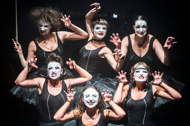 "A photo made available 07 August 2015 of members of the Ukrainian group ""Dakh Daughters Band"" striking poses during their performance at the ""Seebuehne"" (lit: Lakeside stage) within the ""Zuercher Theater Spektakel"" (Zurich Theatre Spectacle) at the ""Landiwiese"" venue in Zurich, Switzerland, late 06 August 2015. (Photo by Dominic Steinmann/EPA)"