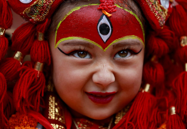 A young girl dressed as the Living Goddess Kumari participates the Kumari Puja festival, in which young girls pose as the Living Goddess Kumari and are worshipped by people in belief that their children will remain healthy, in Kathmandu, Nepal on September 11, 2019. (Photo by Navesh Chitrakar/Reuters)