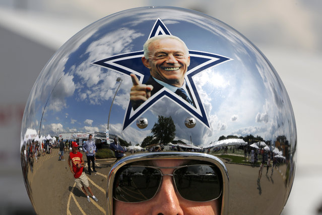 Dallas Cowboys fan Gregg Wilson, of Dallas, arrives for the Pro Football Hall of Fame inductions, including that of Cowboys owner Jerry Jones, whose photo is on the helmet, at the Pro Football Hall of Fame on Saturday, August 5, 2017, in Canton, Ohio. (Photo by Gene J. Puskar/AP Photo)