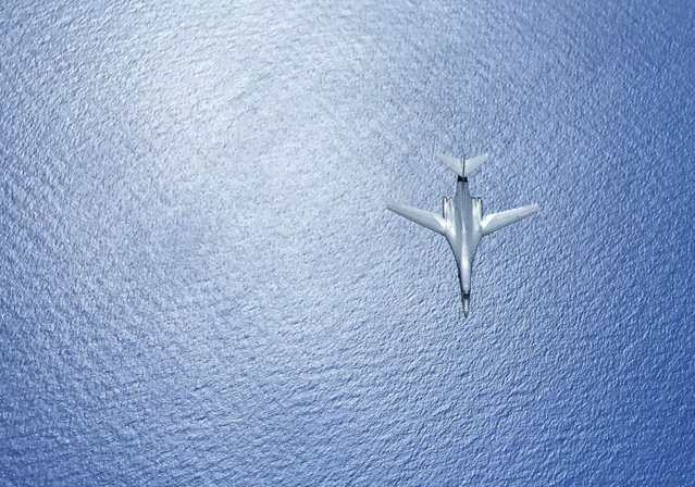 "In this image obtained from the US Department of Defense, a US Air Force B-1B Lancer flies during a 10-hour mission from Andersen Air Force Base, Guam, flying in the vicinity of Kyushu, Japan, the East China Sea, and the Korean peninsula, on August  7, 2017. US Defense Secretary Jim Mattis warned North Korea on August 9, 2017, that it would be ""grossly"" outmatched in any conflict with the US, telling Pyongyang to stop considering any action that risked ""the destruction of its people"". (Photo by Gerald Willis/AFP Photo)"