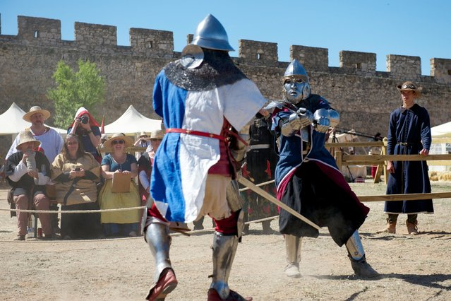 """A member of the USA Knights team, right, battles a knight of Quebec during the International Medieval Combat at the castle of Belmonte, May 4, 2014, in Belmonte, Spain. USA Knights team captain Andre Sinou said the American national team is made up of people """"from all walks of life"""". """"We've got lawyers, doctors, college students, guys that work at gas stations"""", he said. """"This is truly a United States team"""". (Photo by Juan Naharro Gimenez/Getty Images)"""